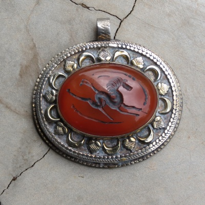 large carnelian pendant with horse detail