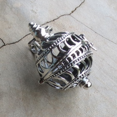silver ornate ball pendant -with opener