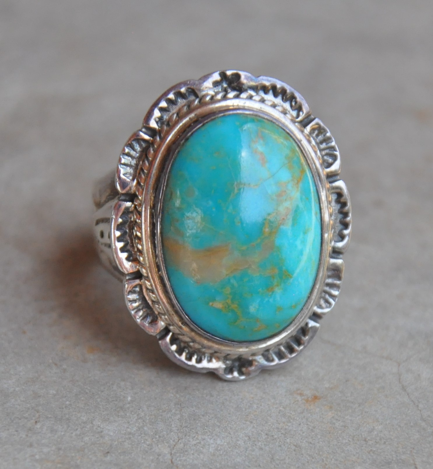 oval mexican silver turquoise ring with detailed border